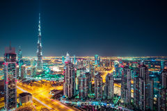 Fantastic nighttime Dubai skyline with illuminated skyscrapers. Royalty Free Stock Images