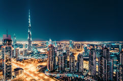 Fantastic nighttime Dubai skyline with illuminated skyscrapers Stock Photo