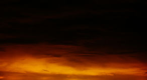Fantastic orange - black sky over the mountains Stock Images