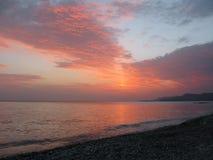 Fantastic orange blue sea ocean sunset shore cloud sky photo Royalty Free Stock Image