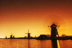 Fantastic orange sunset traditional Dutch windmills canal in Rot Royalty Free Stock Photos