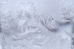Fantastic ornate frosty pattern on winter window glass. Royalty Free Stock Photo