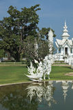 Fantastic palace reflected in a pond Royalty Free Stock Image