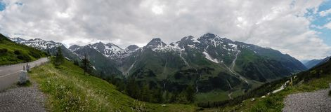 A fantastic panorama or a panoramic banner of the Alps from a vi. A fantastic panorama or a panoramic banner of the Alps from the highest surfaced mountain road Stock Photo
