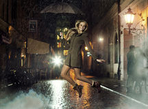 Fantastic photo of attractive girl jumping in heavy rain Royalty Free Stock Images