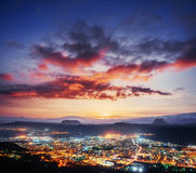 Fantastic pink sunset and cumulus clouds over the city. Beautifu Royalty Free Stock Images