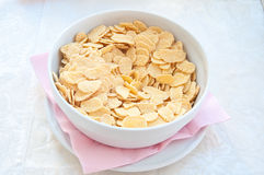 Fantastic porcelain bowls filled with corn flakes cereal Royalty Free Stock Photos