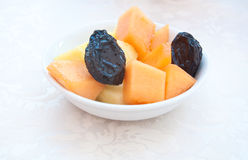 Fantastic porcelain bowls filled with fresh fruit made of Stock Photo