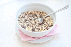 Fantastic porcelain bowls filled with granola cereal Royalty Free Stock Photos