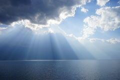 Fantastic rays on the sea. Sun rays through the clouds like the god is coming.backgrounds Royalty Free Stock Images