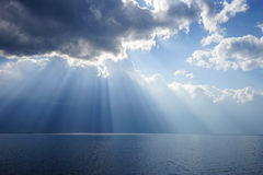 Fantastic rays. Sun rays through the clouds like the god is coming Stock Photos