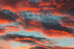 Fantastic red clouds in blue sky during sunset. Fantastic red clouds in blue sky at sunset Stock Photography