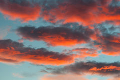 Fantastic red clouds in blue sky during sunset. Fantastic red clouds in blue sky at sunset Royalty Free Stock Image