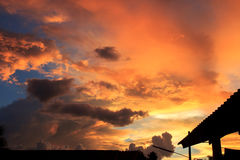 Fantastic red sunset and dark ominous clouds royalty free stock image