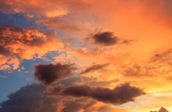 Fantastic red sunset and dark ominous clouds stock photos