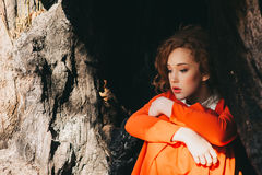 Fantastic redhead girl in a mysterious forest Royalty Free Stock Photography