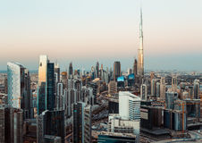 Fantastic rooftop view of Dubai business bay towers at sunset. Royalty Free Stock Photo