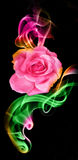 Fantastic rose. A fantastic rose in the colored smoke from aromatic sticks, excellent background Stock Photos