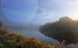 Fantastic Scenery with Large Planet in the Sky over Quiet River Royalty Free Stock Photography