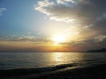 Fantastic sea ocean golden sunset horizon sky photo Stock Images