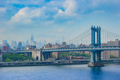 Fantastic shot of the Manhattan Bridge with NYC skyscrapers in t. Great daylight shot in New York City from the Brooklyn Bridge Royalty Free Stock Photo