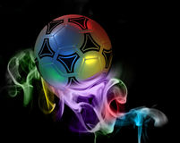 Fantastic soccer ball. A fantastic soccer ball in the colored smoke from aromatic sticks, excellent background Stock Image
