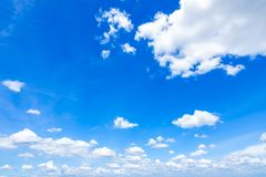 Blue sky with scattered clouds Royalty Free Stock Images