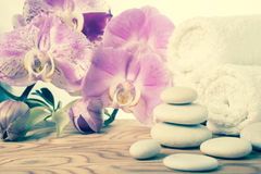 Fantastic Spa still life with stone, lilac orchid and towel Stock Photo
