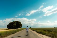 Fantastic spring landscape with one person on the road stock photo