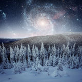 Fantastic starry sky. Beautiful winter landscape and snow-capped Stock Photo