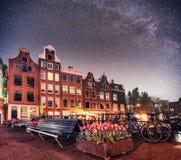Fantastic starry sky at night in Amsterdam. Beautiful illuminati Royalty Free Stock Photo