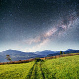 Fantastic starry sky stacks and traditional mountain villages. C Royalty Free Stock Image