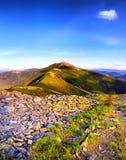 Fantastic sunny hills under morning blue sky. Dramatic landscape Royalty Free Stock Images
