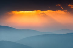 Fantastic sunrise above peaks of smoky mountain with the view into misty hills. Stock Photography