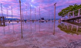 Fantastic sunrise, Ouchy quay. Sailboat and yachts in Ouchy port at fantastic sunrise and beautiful pink blue sky. City of Lausanne, canton Vaud, Switzerland Royalty Free Stock Photos