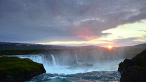 Fantastic sunset. Hodafoss very beautiful Icelandic waterfall 12 meters high. It is located in the north near Lake stock video