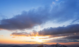 Fantastic sunset in the mountains cumulus clouds. Carpathian, Uk Stock Photography