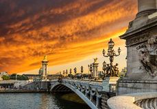 Fantastic  sunset over Alexandre III bridge (Pont Alexandre III) Royalty Free Stock Photo