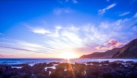 Fantastic Sunset over the Ocean. Fully soak in the mighty glory of a kiwi sunset Royalty Free Stock Images