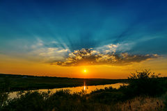 Fantastic sunset over river Stock Photos