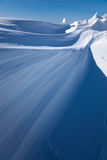 Snow drifts in the sunlight Stock Photo