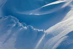 Snow drifts in the sunlight Royalty Free Stock Photography