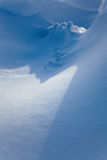 Snow drifts in the sunlight Stock Photos