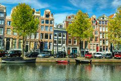 Fantastic traditional buildings and water canal in Amsterdam, Netherlands, Europe Royalty Free Stock Photos