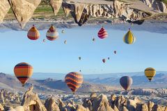 Fantastic turned upside down landscape in Cappadocia, Turkey. Fantastic unreal turned upside down landscape in Kapadokya. Hot air balloons fly in clear morning royalty free stock photo