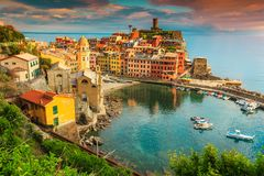 Fantastic Vernazza village with colorful sunset, Cinque Terre, Italy, Europe. Stunning panorama of Vernazza, spectacular colorful medieval buildings and fishing stock image
