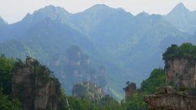 Gorge of canyon mountains in Zhangjiajie park with stunning cliffs in tropics. Fantastic view of the canyon mountain gorge with rock formations in Zhangjiajie stock video