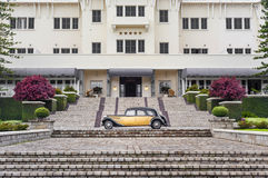 Fantastic view in front of a luxury hotel with a vintage car Royalty Free Stock Photo