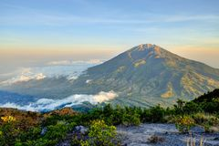 Fantastic view of Merbabu mountain at sunrise from Merapi volcano. Central Java, Indonesia royalty free stock photos