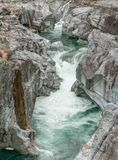 Fantastic view of a mountain river carving ist way through a wild rocky gorge. In southern Switzerland royalty free stock photography